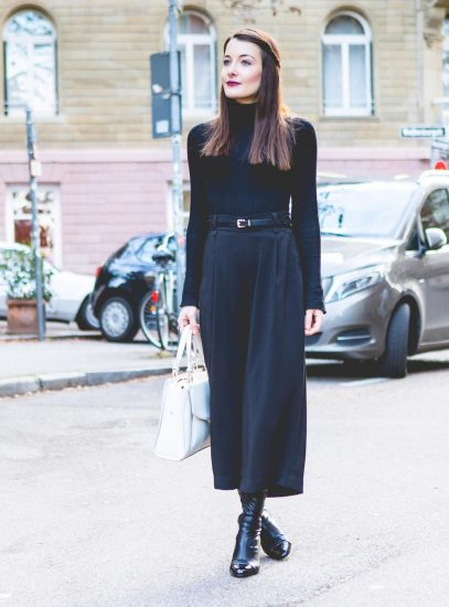 Девушка в стильной одежде чёрного цвета