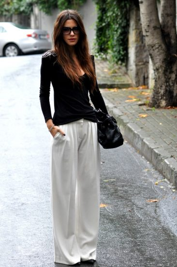 Широкие белые брюки на девушке