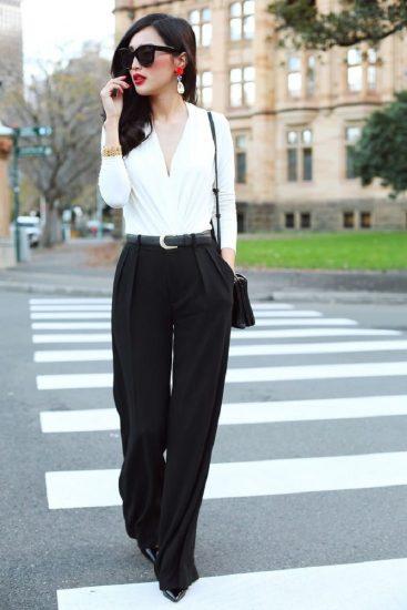 Девушка в белой рубашке и чёрных брюках