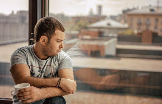 Обиженный мужчина у окна