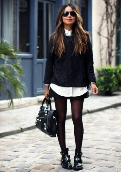 Девушка в чёрном свитшоте, блузке и юбке